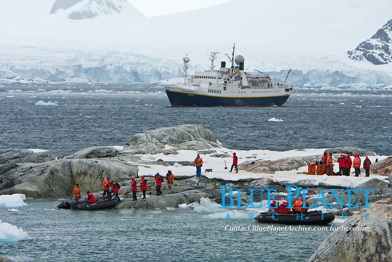 The Lindblad expedition ship National Geographic Endeavour operating with it's fleet of Zodiacs in and around the Antarctic peninsula, Antarctica. Shown here is a landing on Petermann Island on the west side of the peninsula.