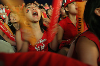 South Korean National Soccer Team fans cheer for their team while watching the FIFA World Cup first round match against France at the Fan Festival in downtown Leipzig, Germany, June 18th, 2006. The teams drew 1-1.