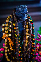 Figure of Father Damien bedecked in leis. A much loved man for his great works and compassion