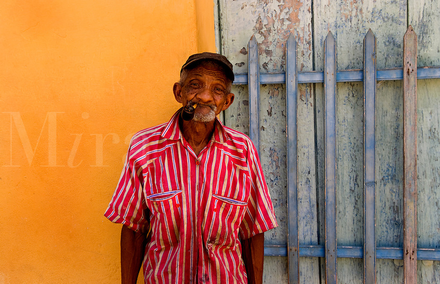 Old man portrait in Trinidad Cuba with red shirt and pipe
