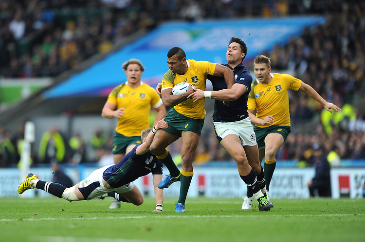 Kurtley Beale of Australia is tackled by Sean Maitland and Finn Russell of Scotland during the Quarter Final of the Rugby World Cup 2015 between Australia and Scotland - 18/10/2015 - Twickenham Stadium, London<br /> Mandatory Credit: Rob Munro/Stewart Communications