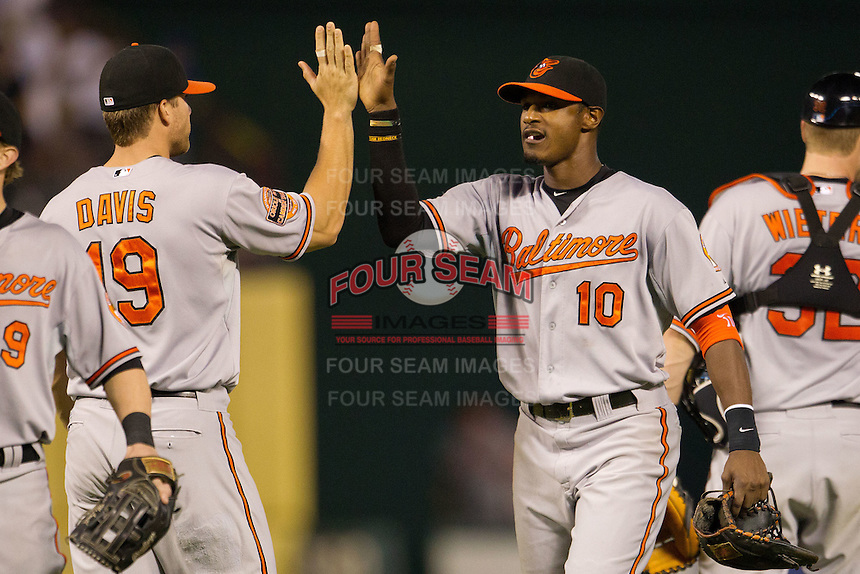 Baltimore Orioles outfielder Adam Jones #10 celebrates following the Major League Baseball game against the Texas Rangers on August 21st, 2012 at the Rangers Ballpark in Arlington, Texas. The Orioles defeated the Rangers 5-3. (Andrew Woolley/Four Seam Images)...