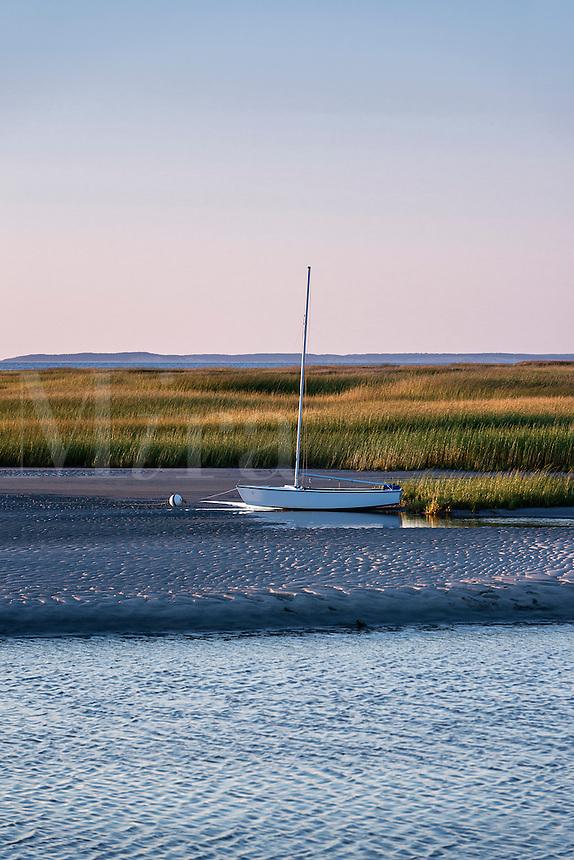 Sailboat moored on tidal flats, Eastham, Cape Cod, Massachusetts, USA