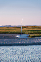 Sailboat moored on tidal flats, Eastham, Cape Cod, Massachusetts, USA