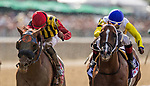 ELMONT, NY - JUNE 09: #10 Bee Jersey, ridden by Ricardo Santana Jr. and #1 Mind Your Biscuits, ridden by Joel Rosario battle to the finish in the Runhappy Metropolitan Handicap on Belmont Stakes Day at Belmont Park on June 9, 2018 in Elmont, New York. (Photo by Eric Patterson/Eclipse Sportswire/Getty Images)