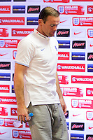 Wayne Rooney of England leaves the press conference