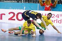 Spain's Viran Morros (c) and Australia's Martin Najdovski (l) and Daniel Kelly during 23rd Men's Handball World Championship preliminary round match.January 15,2013. (ALTERPHOTOS/Acero) /NortePhoto
