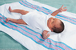 Newborn baby boy, 1 week old reflex Moro (startle), full length on back, lying on receiving blanket