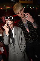 """HOLLYWOOD - FEBRUARY 20: Yungblud and Machine Gun Kelly attend Ozzy Osbourne global tattoo and album listening party to celebrate his new album """"Ordinary Man"""" on February 20, 2020 in Hollywood, California. (Photo by Lionel Hahn/Epic Records/PictureGroup)"""