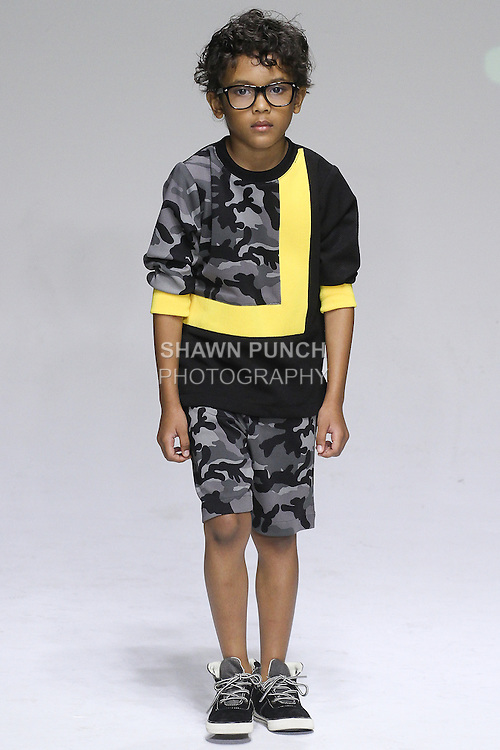 Young model walks runway in an outfit from the Dillonger Clothing Spring Summer 2015 collection by Latoya Fitzgerald, during Kids Fashion Week in New York City, on October 19, 2014.