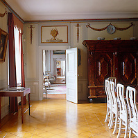 The panels of this dining room are decorated with hand-painted images of garlands and urns