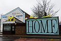 Installations by local artist, Kit, adorn the scaffolding and buildings on Hornsey Road, Upper Holloway, North London. Kit's yellow stick figures, made out of the foam that protects people from bumps with scaffolding poles, are a familiar sight along the road. This fresh crop is especially abundant, cheering up a grey day during lockdown 3 of the Covid-19 pandemic.