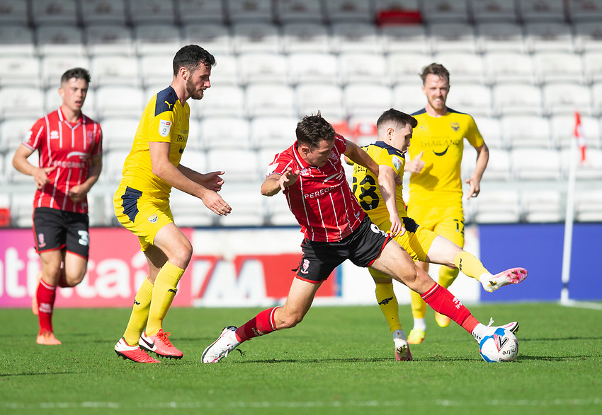 Lincoln City's Tom Hopper battles with Oxford United's Liam Kelly<br /> <br /> Photographer Andrew Vaughan/CameraSport<br /> <br /> The EFL Sky Bet League One - Saturday 12th September  2020 - Lincoln City v Oxford United - LNER Stadium - Lincoln<br /> <br /> World Copyright © 2020 CameraSport. All rights reserved. 43 Linden Ave. Countesthorpe. Leicester. England. LE8 5PG - Tel: +44 (0) 116 277 4147 - admin@camerasport.com - www.camerasport.com - Lincoln City v Oxford United