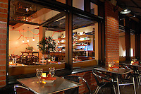Heat Bar & Kitchen--a tenant improvement. Warm, inviting atmosphere  evokes heat and fire but provides cool, clean aesthetic during day. Cracked Lava Wall glows red at night. Laurie Fisher, architect