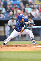 Asheville Tourists catcher Javier Guevara (9) squares to bunt during a game against the West Virginia Power at McCormick Field on April 18, 2019 in Asheville, North Carolina. The Power defeated the Tourists 12-7. (Tony Farlow/Four Seam Images)