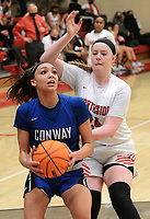 Conway's Jaiden Thomas (24), left, looks to shoot from the lane as Northside's Tracey Bershers (24) defends in the third quarter on Friday, Feb. 12, 2021 in Gayle Kaundart-Grizzly Fieldhouse in Fort Smith. Conway won the game 69-56. (Special to NWA Democrat Gazette/Brian Sanderford)