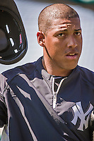 11 March 2014: New York Yankees infielder Yangervis Solarte awaits his turn in the batting cage prior to a Spring Training game against the Washington Nationals at Space Coast Stadium in Viera, Florida. The Nationals defeated the Yankees 3-2 in Grapefruit League play. Mandatory Credit: Ed Wolfstein Photo *** RAW (NEF) Image File Available ***