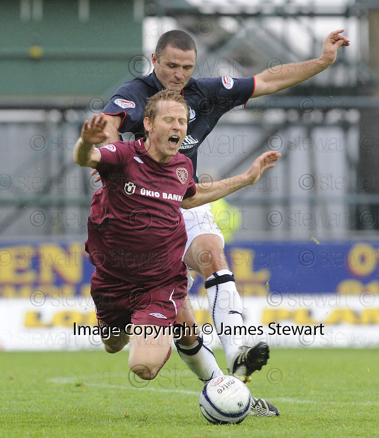 13/09/2008  Copyright Pic: James Stewart.File Name : sct_jspa13_falkirk_v_hearts.MICHAEL STEWART IS BROUGHT DOWN BY MICHAEL HIGDON.James Stewart Photo Agency 19 Carronlea Drive, Falkirk. FK2 8DN      Vat Reg No. 607 6932 25.James Stewart Photo Agency 19 Carronlea Drive, Falkirk. FK2 8DN      Vat Reg No. 607 6932 25.Studio      : +44 (0)1324 611191 .Mobile      : +44 (0)7721 416997.E-mail  :  jim@jspa.co.uk.If you require further information then contact Jim Stewart on any of the numbers above........