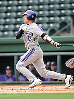 Catcher Jake Straub (11) of the Northwestern Wildcats hits in a game against the Furman University Paladins on Saturday, February 16, 2013, at Fluor Field in Greenville, South Carolina. The game was cancelled in the fifth inning due to snow. (Tom Priddy/Four Seam Images)