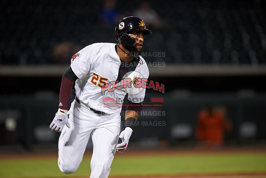 Mesa Solar Sox Jo Adell (25), of the Los Angeles Angels organization, runs to first base during an Arizona Fall League game against the Scottsdale Scorpions on September 18, 2019 at Sloan Park in Mesa, Arizona. Scottsdale defeated Mesa 5-4. (Zachary Lucy/Four Seam Images)