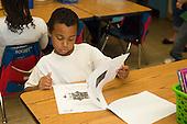 MR / Schenectady, New York. Yates Arts-in-Education Magnet School (urban public school). First grade classroom. Student (boy, 6, biracial) taking test. MR: Gig1. ID: AM-g1w. © Ellen B. Senisi.