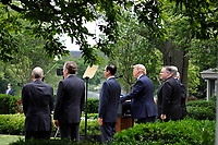 United States President Donald J. Trump with members of his administration delivers remarks on China in the Rose Garden at the White House in Washington, DC on May 29, 2020. Pictured from left to right: US Secretary of State Mike Pompeo; the president; US Secretary of the Treasury Steven T. Mnuchin; Ambassador Robert Lighthizer, United States Trade Representative; and Director of the National Economic Council Larry Kudlow.<br /> Credit: Yuri Gripas / Pool via CNP/AdMedia