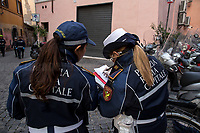 """Roma Capitale Police checks my self-certification. Press: allowed.<br /> <br /> Trastevere.<br /> <br /> Rome, 12/03/2020. Documenting Rome under the Italian Government lockdown for the Outbreak of the Coronavirus (SARS-CoV-2 - COVID-19) in Italy. On the evening of the 11 March 2020, the Italian Prime Minister, Giuseppe Conte, signed the March 11th Decree Law """"Step 4 Consolidation of 1 single Protection Zone for the entire national territory"""" (1.). The further urgent measures were taken """"in order to counter and contain the spread of the COVID-19 virus"""" on the same day when the WHO (World Health Organization, OMS in Italian) declared the coronavirus COVID-19 as a pandemic (2.).<br /> ISTAT (Italian Institute of Statistics) estimates that in Italy there are 50,724 homeless people. In Rome, around 20,000 people in fragile condition have asked for support. Moreover, there are 40,000 people who live in a state of housing emergency in Rome's municipality.<br /> March 11th Decree Law (1.): «[…] Retail commercial activities are suspended, with the exception of the food and basic necessities activities […] Newsagents, tobacconists, pharmacies and parapharmacies remain open. In any case, the interpersonal safety distance of one meter must be guaranteed. The activities of catering services (including bars, pubs, restaurants, ice cream shops, patisseries) are suspended […] Banking, financial and insurance services as well as the agricultural, livestock and agri-food processing sector, including the supply chains that supply goods and services, are guaranteed, […] The President of the Region can arrange the programming of the service provided by local public transport companies […]».<br /> Updates: on the 12.03.20 (6:00PM) in Italy there 14.955 positive cases; 1,439 patients have recovered; 1,266 died.<br /> <br /> Footnotes & Links:<br /> Info about COVID-19 in Italy: http://bit.do/fzRVu (ITA) - http://bit.do/fzRV5 (ENG)<br /> 1. March 11th Decree Law http://bit.do/fzREX (ITA) """