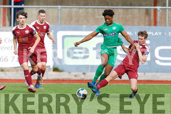 Kerry's Daniel Dkwite been tackled by Galway's Blake Crurran in the U19 Soccer league on Sunday