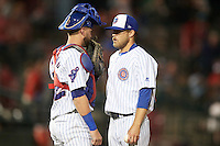 South Bend Cubs catcher Tyler Alamo (22) talks with relief pitcher John Williamson (20) during a game against the Burlington Bees on July 22, 2016 at Four Winds Field in South Bend, Indiana.  South Bend defeated Burlington 4-3.  (Mike Janes/Four Seam Images)