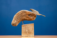BNPS.co.uk (01202 558833)<br /> Pic: MaxWillcock/BNPS<br /> <br /> Pictured: 'Grounded Rootler', a driftwood sculpture on a wooden plinth, created by artist Sid Bunard in 2008.<br /> <br /> Twelve eye-catching driftwood sculptures by one of Britain's most eccentric artists have emerged for sale.<br /> <br /> Brighton-born Sid Burnard uses objects washed up on beaches to fashion unusual artworks of humans and animals.<br /> <br /> They are going under the hammer with auctioneers Woolley & Wallis where they could sell for a combined £4,000.<br /> <br /> The collection includes an impressive Jabiru bird whose beak is made out of a fragment of an orange buoy.