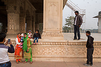 People take selfies near buildings inside the Red Fort in Delhi, India, on Tue., Dec. 11, 2018.