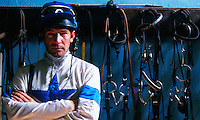 Portrait of a jockey in tackroom setting.
