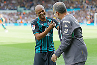 LEEDS, ENGLAND - AUGUST 31: (L-R) Andre Ayew of Swansea City greets Leeds United manager Marcelo Bielsa during the Sky Bet Championship match between Leeds United and Swansea City at Elland Road on August 31, 2019 in Leeds, England. (Photo by Athena Pictures/Getty Images)
