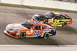 Nationwide Series driver Eric McClure (14) and Ryan Sieg (39) in action during the NASCAR Nationwide Series O'Reilly Auto Parts 300 race at Texas Motor Speedway in Fort Worth,Texas.