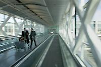 Airport passageway businessmen, Logan Airport, Boston, MA (Cambridge 7)