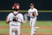 Arkansas Kevin Kopps (45) reacts, Monday, June 7, 2021 in the ninth inning of the NCAA Fayetteville Regional at Baum-Walker Stadium in Fayetteville. Check out nwaonline.com/210608Daily/ for today's photo gallery. <br /> (NWA Democrat-Gazette/Charlie Kaijo)