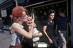 Punk girls teenagers kiss walking along in the   Kings Road,  Chelsea London England  1970s UK 1979