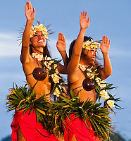 Two women dancing hula in coconut shell tops at the 2011 Kauai Polynesian Festival