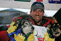 Tuesday March 13, 2007   ----   Lance Mackey, the 2007 Iditarod champion hugs his lead dogs Larry and Lippy at the finish line