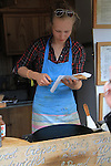 Woman making crepes at Jardin du Luxembourg, Paris, France.