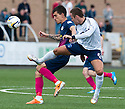 Morton's Stefan Milojevic and Forfar's Stephen Husband challenge for the ball.