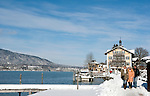 Germany, Bavaria, Upper Bavaria, Tegernseer Valley, Winter at Lake Tegern: winter walk at lakefront walk, background Tegernsee townhall