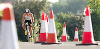 28 JUL 2013 - LONDON, GBR - Paul Lunn negotiates the traffic cones marking the bike route during the 2013 Virgin Active London Triathlon at Royal Victoria Dock in London, Great Britain  (PHOTO COPYRIGHT © 2013 NIGEL FARROW, ALL RIGHTS RESERVED)