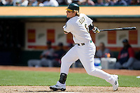 6 April 2008: A's #6 Travis Buck hits the ball during the Cleveland Indians 2-1 victory over the Oakland Athletics at the McAfee Coliseum in Oakland, CA.