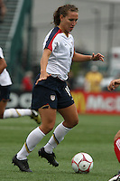 USWNT's Lauren Cheney (19) dribbles the ball. The U.S. Women's National Team defeated 1-0 in a friendly match at Marina Auto Stadium in Rochester, NY on July 19, 2009. Abby Wambach of the USWNT scored her 100th career goal in the second half..