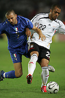 Italian forward (7) Alessandro Del Piero collides with German midfielder (22) David Odonkor.  Italy defeated Germany, 2-0, in overtime in their FIFA World Cup semifinal match at FIFA World Cup Stadium in Dortmund, Germany, July 4, 2006.