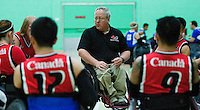 15 AUG 2011 - LEEDS, GBR - Canadian Head Coach Kevin Orr gives a team talk before the wheelchair rugby exhibition match between Great Britain and Canada (PHOTO (C) NIGEL FARROW)