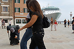 Venice Italy 2009. Cruise ship  passengers Rumanian gypsy woman begging
