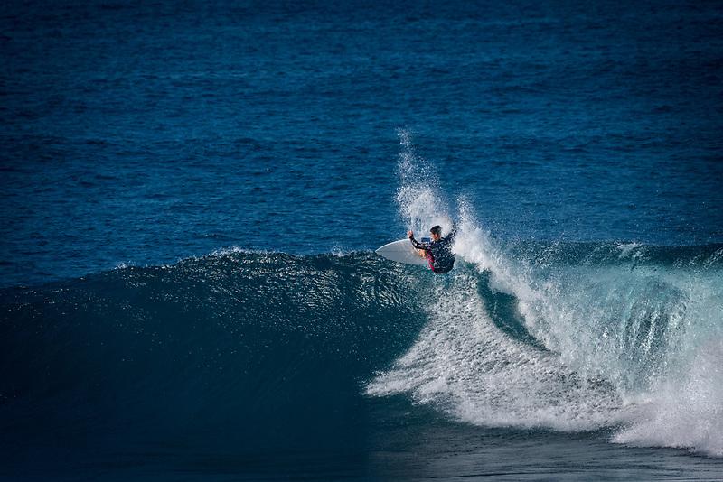 Surfer at Hookipa Beach. Maui, Hawaii