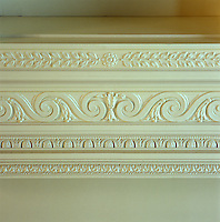 This neo-classical frieze framing the ceiling of a grand entrance hall consists of bands of elaborate plasterwork